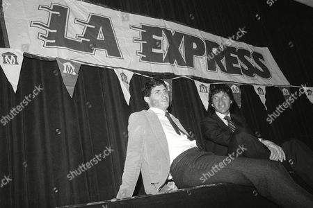 Brigham Young University quarterback Steve Young, with his attorney Leigh Steinberg, sits back after signing a $40 million over 43 years contract with the United States Football League's Los Angeles Express, in Los Angeles