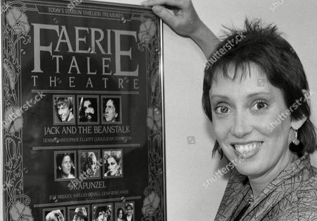 """Shelley Duvall poses in Los Angeles, beside a poster for her """" Faerie Tale Theatre, """" which runs on the Showtime pay television network"""