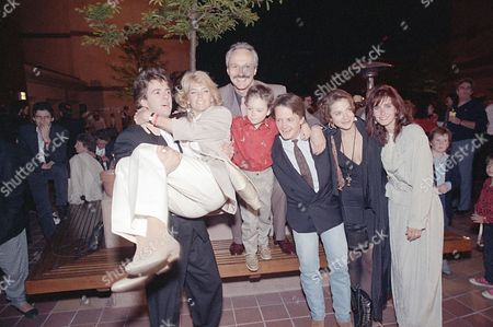 """Stock Picture of Valentine Birney Gross Bonsall F Cast members of NBC's """"Family Ties,"""" from left: Scott Valentine, Meredith Baxter Birney, Michael Gross, Brian Bonsall, Michael J. Fox, Justine Bateman and Courteney Cox, celebrate their seventh and final season, during a wrap party at the Gene Autry Western Heritage Museum in Los Angeles"""