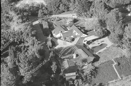 This is an aerial view of the $2.5 million home, shown, actor Lee Majors decided to give to his former wife, actress Farrah Fawcett-Majors, saying he believed she deserved it and that he still loved her very much. The Los Angeles hilltop home had been fought over by Majors and Fawcett during divorce proceedings