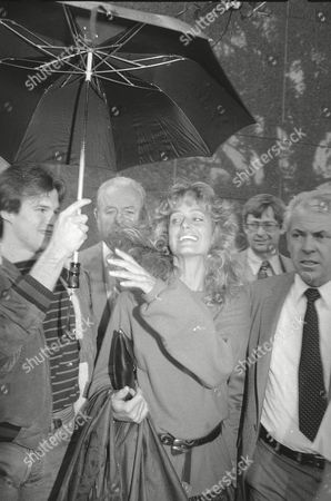 Actress Farrah Fawcett leaves the Los Angeles Superior Court in the rain after testfying in the divorce and property settlement trial portion of the lawsuit with estranged husband Lee Majors, . The property settlement dispute is the last roadblock to final dissolution of the marriage