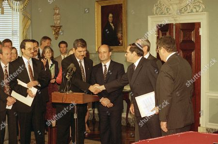 Jordan-Israel peace 1993 Fayez Tarawneh, Jordan's ambassador to the U.S., left, shakes hands with Elyakim Rubinstein head of the Israeli delegation to the Jordan-Israel peace talks after they signed a peace agreement at the State Department in Washington . Victor Posuvaluk of the Russian Foreign Ministry, center, and Secretary of State Warren Christopher look on