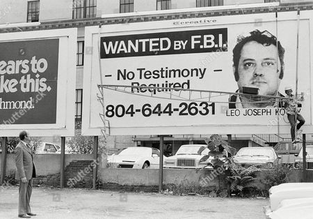 Leo Joseph Koury, who is on the FBI's 10 Most Wanted list, is shown on an FBI billboard in Richmond, Va., . He is wanted on charges including murder, racketeering and extortion