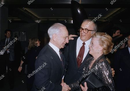 "Federico Fellini, Giulietta Masina Italian movie director Federico Fellini, center, his wife Giulietta Masina, right, are shown celebrating the opening of Fellini's movie ""Ginger and Fred,"", New York. The man on the left is unidentified"