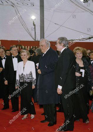 Stock Picture of Federico Fellini, Giulietta Masina, Marcello Mastroianni Federico Fellini, center, arrives at the Academy Awards in Los Angeles at night, with his wife, Giulietta, and actor Marcello Mastroianni. Fellini will receive an honorary award