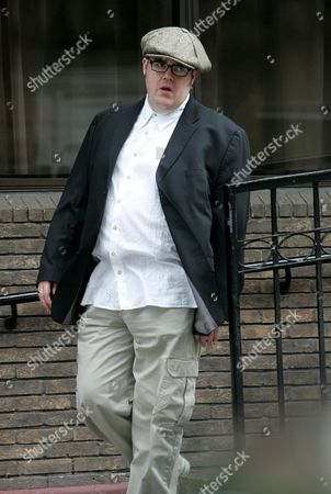 Philll Jupitus leaves Princess Grace Hospital after visiting his wife who is having a hip replacement.