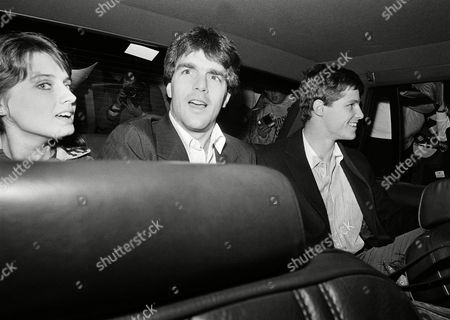 Doug Flutie, Gerard Phelan, Laurie Fortier Boston College quarterback Doug Flutie, center, and teammate Gerard Phelan, right, look at the crowd of well-wishers from the inside of a Massachusetts State Police cruiser as they prepare to depart from Logan International Airport in Boston after returning from Miami, . Flutie threw a touchdown pass to Phelan with no time left on the clock to nip the University of Miami 47-45. Flutie's girlfriend Laurie Fortier is at left