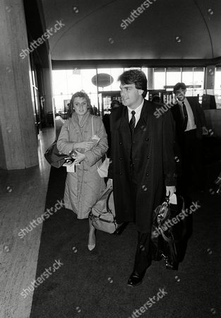 Doug Flutie, Laurie Fortier Heisman Trophy winner Doug Flutie, right, with his fiancee Laurie Fortier, left, head for a plane to New York, at Boston's Logan International Airport, . Flutie is scheduled to have a press conference in New York regarding his signing with the United States Football League's New Jersey Generals