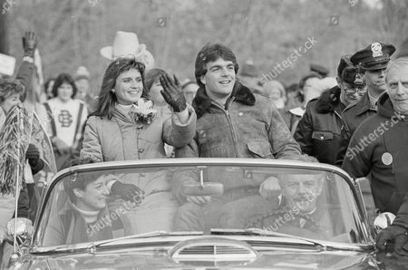 Doug Flutie, Laurie Fortier Heisman Trophy winner Doug Flutie of Boston College reacts as he rides in a motorcade with his fiancee Laurie Fortier during a parade held in his honor in his hometown of Natick, Mass