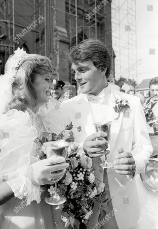 Doug Flutie, Laurie Fortier New Jersey Generals quarterback Doug Flutie, right, shares a champagne toast with his bride Laurie Fortier, outside St. Patrick's Church in Natick, Mass., following their wedding ceremony, . Flutie won the Heisman Trophy while playing for Boston College last year