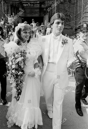 Doug Flutie, Laurie Fortier New Jersey Generals quarterback Doug Flutie, right, walks with is bride Laurie Fortier outside St. Patrick's Church in Natick, Mass., following their wedding ceremony. Flutie won the Heisman Trophy while playing for Boston College last year