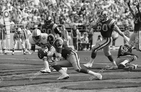 Eric Dickerson, Patrick Allen Ram running back Eric Dickerson (29) scoops up the ball after dropping it on the way for a touchdown in the first quarter of game on in Anaheim against the Houston Oilers. Oiler cornerback Patrick Allen presses, left. The play was ruled a touchdown