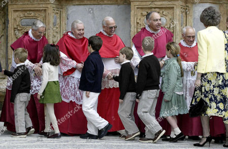 Cousins Prince Miguel, Princess Victoria Federica, Prince Felipe Juan Froilan, Prince Pablo Nicolas, Prince Juan Valentin with Grandmother Queen Sofia greeting the clergy after Easter Mass