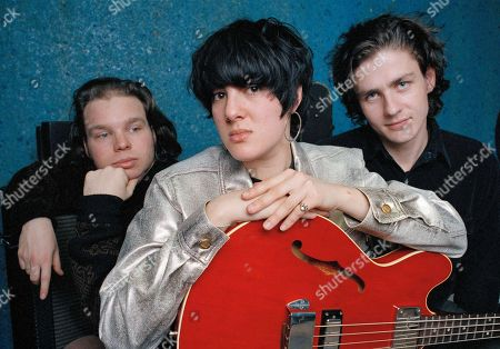 """Damon Krukowski, Naomi Yang, Dean Wareham Members of the indie band Galaxie 500 pose in Boston, Mass., . From left are: Damon Krukowski, drums; Naomi Yang, bass and Dean Wareham, guitar and vocals. The band, which has a strong cult following, just released their second album, """"On Fire"""