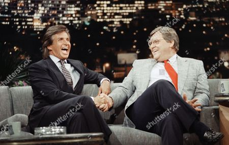"""George Hamilton, Denny McLain Actor George Hamilton, left, and former Detroit Tigers pitcher Denny McLain share a laugh during The Pat Sajak Show in Los Angeles, . McLain, the last major League pitcher to win 30 games, spoke with Sajak about the gambling problems confronting Cincinnati Reds manager Peter Rose. McLain was suspended in 1970 for betting on football and basketball games and said a lifetime ban against Rose would be """"too severe. Gambling is a sickness and Rose deserves treatment for his problems"""