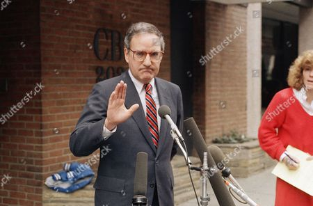 "George Mitchell Sen. George Mitchell, D-Maine, gestures to reporters outside CBS studios in Washington, after appearing on the TV network's ""Face the Nation,"" where the topics was the controversy surrounding Attorney General Edwin Meese III"