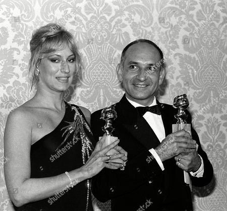"Kingsley Bergman Actress Sandahl Bergman and British actor Ben Kingsley pose with their Golden Globe awards at the Beverly Hilton Hotel in Hollywood, Ca., . Bergman won new star of the year in a motion picture, female, in ""Conan the Barbarian,"" and Kingsley won best actor for his portrayal of the title role in ""Gandhi"