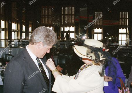 Stock Photo of Bill Clinton, Gael Greene Arkansas Gov. Bill Clinton receives a gift of a brightly colored handkerchief from food critic Gael Greene during a visit to the fifth annual women's power lunch in New Yorkn attended by 300 of some of the nation's most influential women. Greene obscures her identity in order to befuddle restaurant staffs who are on the lookout for her in their eateries