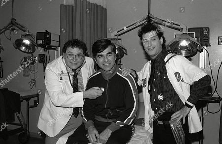 Michael Dukakis, Stephen Furst, Howie Mandel Massachusetts Gov. Michael Dukakis, center, receives treatment from Stephen Furst, left and Howie Mandel, stars of NBC?s television series ?St. Elsewhere? in Los Angeles, during taping on Friday for an episode in which Dukakis plays himself and receives treatment for a foot injury suffered while jogging