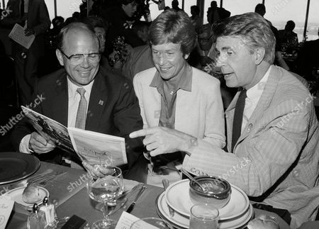 """Allen Olson, Barbara Olson, James Noble North Dakota's Gov. Allen I. Olson, left, and his wife, Barbara, peruse the day's racing program with actor James Noble, who portrays Gov. Gene Gatling on the TV series, """"Benson,"""" at the running of the Hambletonian at the Meadowlands in East Rutherford, N.J., . More than a dozen of the nation's governors spent a day at the races on the eve of the National Governor's Conference in Atlantic City, N.J"""