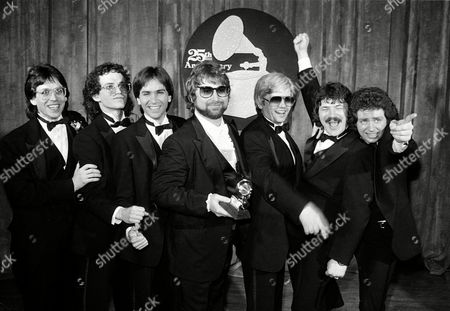 """Toto Band members of Toto pose after winning six Grammys during the 25th Annual Grammy Awards presentation in Los Angeles, Ca., . Among the awards are record of the year for """"Rosanna,"""" album of the year for """"Toto IV,"""" and best instumental arrangement accompanying vocals for """"Rosana."""" From left are, Jeff Porcaro, Steve Porcaro, Michael Porcaro, Dave Paich, Dave Herngate, Bobby Kimball and Steve Lukather"""