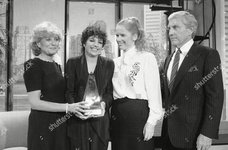 Talk show host Merv Griffin, far right, is shown with TV journalist Barbara Walters, left, entertainer Liza Minnelli, center, and and actress Liv Ullman, as he presents the Celanese Meridian Award backstage of his television show