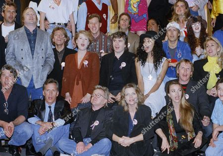 "Part of a group of over 100 celebrities sing during a playback of their recorded song ""Voices That Care"" at Warner Brothers Studios in Burbank, California on . Included is in front from left, Richard Gere, James Woods, Paul Williams, Michelle Pfeiffer, Jane Seymour and Fred Savage. In the second row is Kevin Costner, Stephen Stills, Peter Cetera, Meryl Streep, Dudley Moore, Julie Brown, Gary Busey and Linda Thompson Jenner. In back is Orel Hersheiser, Henry Winkler, Nell Carter, Chevy Chase, Brooke Shields, Tiffany and David Cassidy"