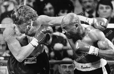 Middleweight champ Marvin Hagler, right, connects to the face of London's Tony Sibson in the first round of their title fight at the Centrum, in Worcester, Mass. Hagler won with a 6th round TKO