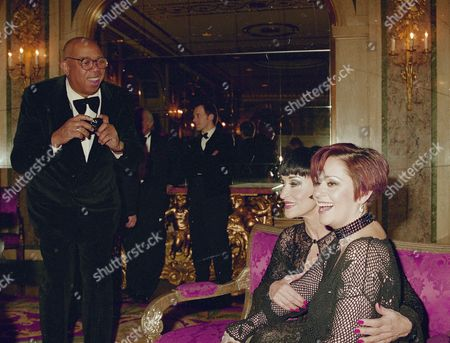 Choreographer Geoffrey Holder, left, tries to take a picture of actress Chita Rivera and her daughter Lisa Mordente, right, as they pose for photographers during a benefit for Hale House in New York, . Hale House is a non-profit agency for children born addicted to drugs, alcohol, or infected with the AIDS virus, and their families