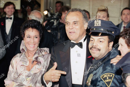 Harry Belafonte, accompanied by his wife Julie Belafonte, gives Lincoln center security guard Leonard Ferrara a brief shot at fame as he embraces him while entering the Film Society of Lincoln Center's Gala Tribute to Gregory Peck in New York, . Belafonte joined a host of luminaries at the tribute to Peck's long and varied career