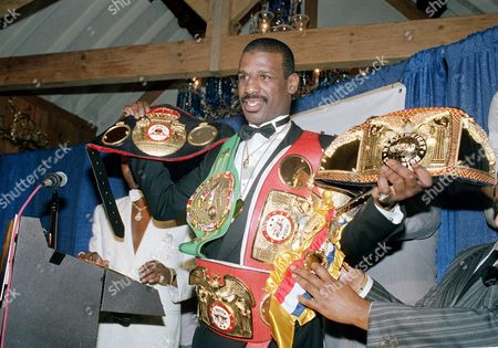 Spinks Heavyweight boxer Michael Spinks displays his championship belts at a news conference where he announced his retirement from the ring in New York City on