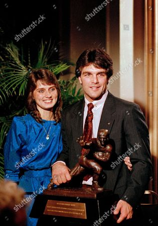 Doug Flutie, Laurie Fortier Heisman Trophy winner Doug Flutie of Boston College poses with his high School girlfriend Laurie Fortier at the Downtown Athletic Club awards ceremony in New York