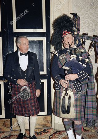 "Hugh Downs, Charlie Kron Hugh Downs is serenaded by bagpiper Charlie Kron at the 1987 Scottish Ball in New York, . Downs, co-host of ABC-TV's newsmagazine show ""20/20"", showed up in the kilt of the Cameron Clan to which he belongs"
