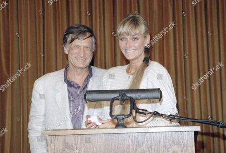 Stock Image of Playboy magazine founder and publisher Hugh Hefner, left, stands with Kimberly Conrad during a news conference, Los Angeles, Calif. Hefner announced plans to file a cross-complaint against his former companion Carrie Leigh. Leigh filed a $35 million palimony suit against Hefner