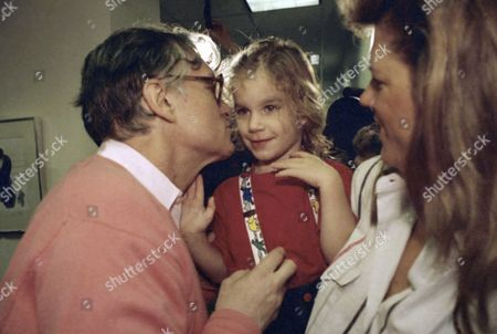 Playboy magazine founder Hugh Hefner, left, kisses his son Marston Hefner, 2½, during a tour of the new playboy corporate headquarters, Chicago, Ill. Hefner was in town for the Chicago Film Festival premiere of Hugh Hefner: Once Upon a Time, a documentary of the publishers life