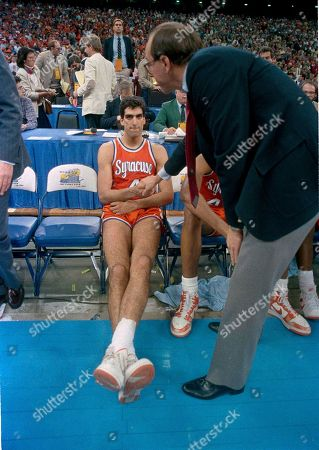Syracuse coach Jim Boeheim shakes the hand of player Rony Seikaly after they lost the NCAA Championship game to Indiana, 74-73 in New Orleans