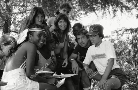 Jane Fonda, center left, and her husband, Tom Hayden, center right, work with a group of youngsters who attend Laurel Springs Camp in the Los Padres National Forest near Santa Barbara on in Santa Monica, California. The camp, finances in part by the couple, includes scholarship supported youngsters from the ghetto as well as children of such stars as Willy Nelson, Jon Voigt and Margot Kidder