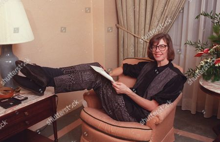 """Stock Photo of JANE SMILEY Author Jane Smiley relaxes in her New York hotel room in November 1991. She was in town to promote her new novel """"A Thousand Acres."""" The book tells the King Lear-like story of an Iowa farmer who turns over his land to his three daughters, and soon decends into madness, accusing the two elder children of stealing his property"""