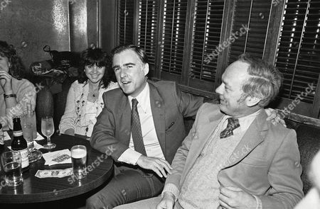 Citizen Jerry Brown Jr. celebrates with pop singer Linda Ronstadt, left,and other friends in a Sacramento cocktail lounge shortly after stepping down as governor of California at midnight, . Republican George Deukmejian replaces Brown and will take his oath of office later today. Man at right is unidentified