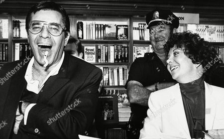 Comedian Jerry Lewis, left, with his fiancée Sandee Pitnick, clowns around during an autograph session at a bookstore where he was promoting his new book, Jerry Lewis in Person, Cambridge, Mass