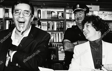 "Comedian Jerry Lewis, left, with his fiancée Sandee Pitnick, clowns around Saturday during an autograph session on at a Cambridge, Mass., bookstore where he was promotong his new book, ""Jerry Lewis in Person"