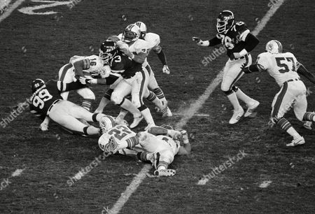 Stock Photo of Mark Gastineau, Joe Klecko, David Woodley New York Jets defensive lineman Mark Gastineau (99) and Joe Klecko, rihgt, sack the Miami Dolphins quarterback David Woodley in the second half of their 16-15 win over Miami at New York's Shea Stadium, . Among the league leaders in sacks, Klecko has 16 and Gastineau 15 1/2