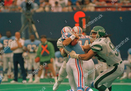 Mark Gastineau, Cody Carlson New York Jets Mark Gastineau, right, gets to Houston Oilers quarterback Cody Carlson for a sack in the second quarter of the 45-3 Jets win at Giants Stadium in East Rutherford, N.J