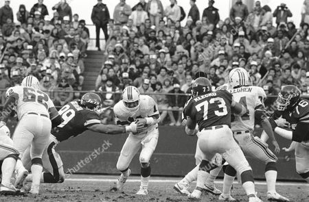 Stock Image of New York Jets Mark Gastineau reaches for rookie New England Patriots quarterback Tony Eason and nails him for a third period sack at Shea Stadium, New York. It was one of three sacks that Gastineau had a part in, as the Jets swamped New England 26-3. Jets Joe Klecko (73). The rest of the players are unidentified