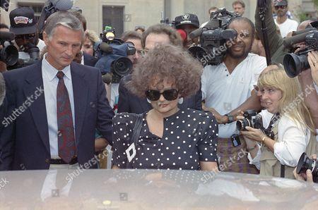 Dershowitz Bakker Tammy Faye Bakker, wife of former PTL leader Jim Bakker, is seen as she arrives at the federal courthouse in Charlotte, N.C., for her husband's resentencing hearing on a 45-year prison sentence. Attorney Alan Dershowitz is at right