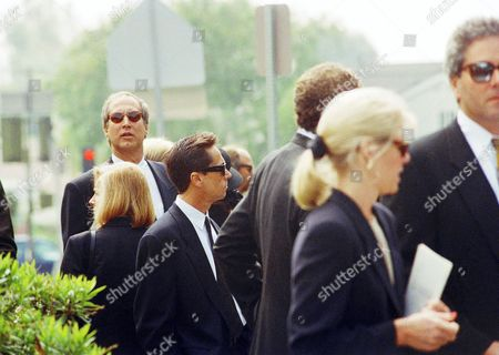 """Chevy Chase attends the funeral of John Candy at St. Martin of Tours Catholic Church in Los Angeles, . Chase starred with John Candy in the film """"National Lampoon's Vacation"""