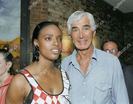 John DeLorean escorts his girlfriend Coco Mitchell to the Silverbird restaurant on New York's West Side, at evening in New York. The couple attended the private opening of the American Indian restaurant