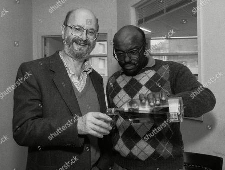 Stock Photo of Jules Feiffer, Stanley Crouch Pulitzer price winner, for cartoonists, Jules Feiffer, left, smiles as Village Voice writer Stanley Crouch, right, pours him a drink in New York on . Feiffer, a cartoonist for the Voice won the Pulitzer on Thursday