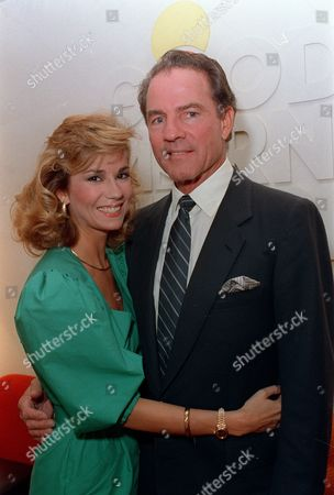 "Johnson Gifford ABC sports commentator Frank Gifford and fiancee, talk show host Kathy Lee Johnson, pose in front of the ""Good Morning America"" sign at ABC studios in New York City on"