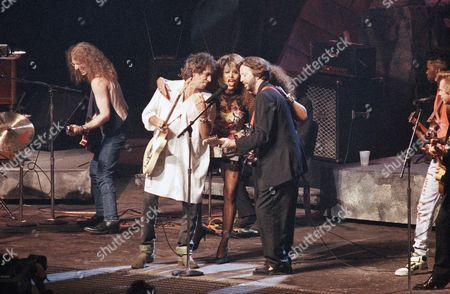 Keith Richard; Rolling Stones; rock 'n' roll Rock stars Keith Richards, Tina Turner and Eric Clapton perform during the International Rock Awards in New York, . Back up singer Sarah Dash is behind Clapton and guitarist Waddy Wachtel plays at left